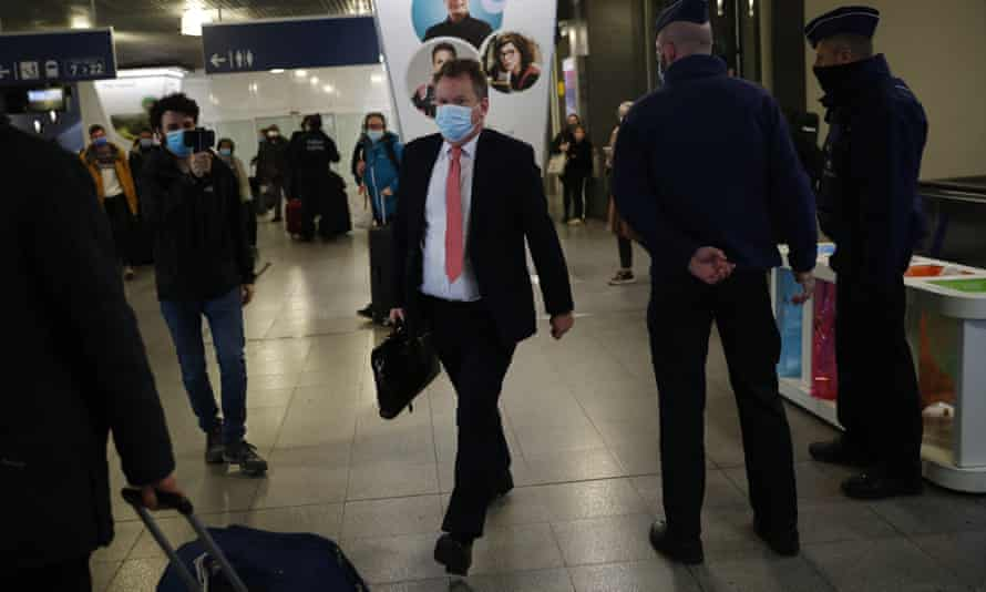 Britain's chief negotiator, David Frost, wears a protective face mask as he arrives in Brussels for Brexit talks.