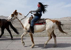 Stephanie Big-Eagle rides with other Fort Laramie treaty riders along Bombing Range Rd. on the Pine Ridge Reservation near Scenic, South Dakota