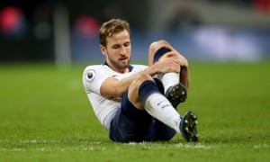 Harry Kane nurses his ankle after the final whistle of Tottenham's 1-0 defeat to Manchester United on Sunday.