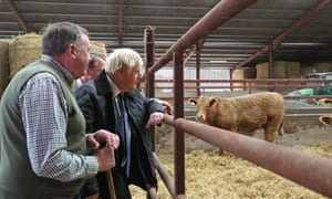 Boris Johnson (right) being shown around Darnford Farm in Banchory near Aberdeen