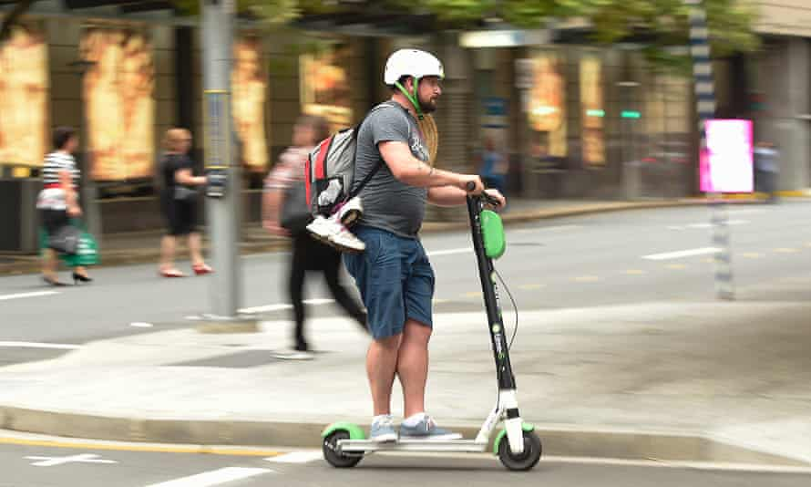 A man rides an e-scooter in Brisbane's CBD. Queensland is the only state or territory in Australia where an electric scooter above 200 watts can be ridden on footpaths.