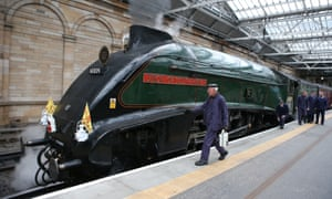 The Union of South Africa steam locomotive arrives at Edinburgh's Waverley station to carry the Queen to Tweedbank.