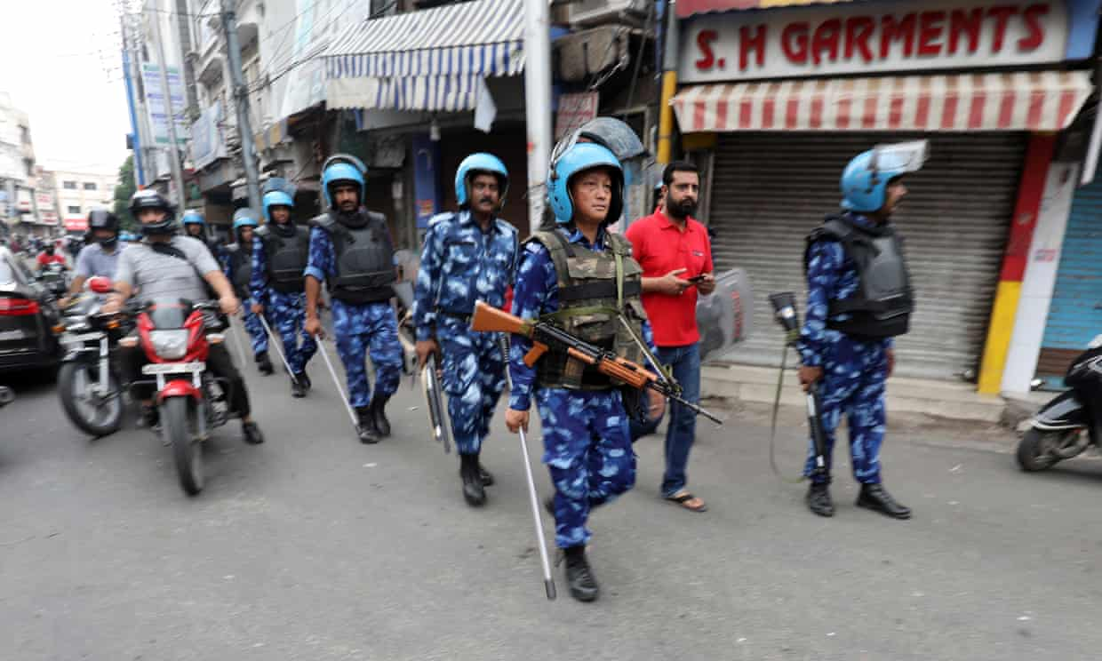 Indian troops patrol the streets of the city of Jammu, in Kashmir, on Friday.