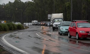 Traffic lined up at the Pacific Highway roadblock outside Taree NSW wait to resume their journey north late on Sunday afternoon. Sunday 21st March 2021. Photograph by Mike Bowers. Guardian Australia.