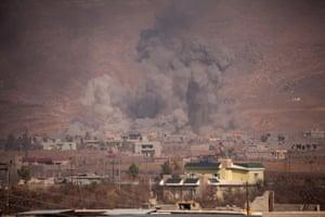 Smoke rises from rubble