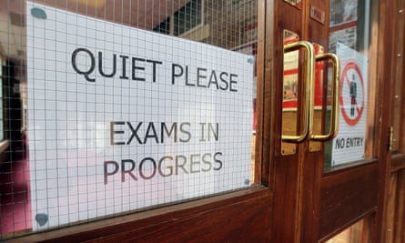 A sign reads 'quiet please, exams in progress'.