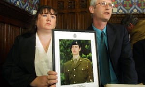 Diane and Geoff Gray with a photo of their dead son Private Geoff Gray who died at Deepcut barracks in 2001.