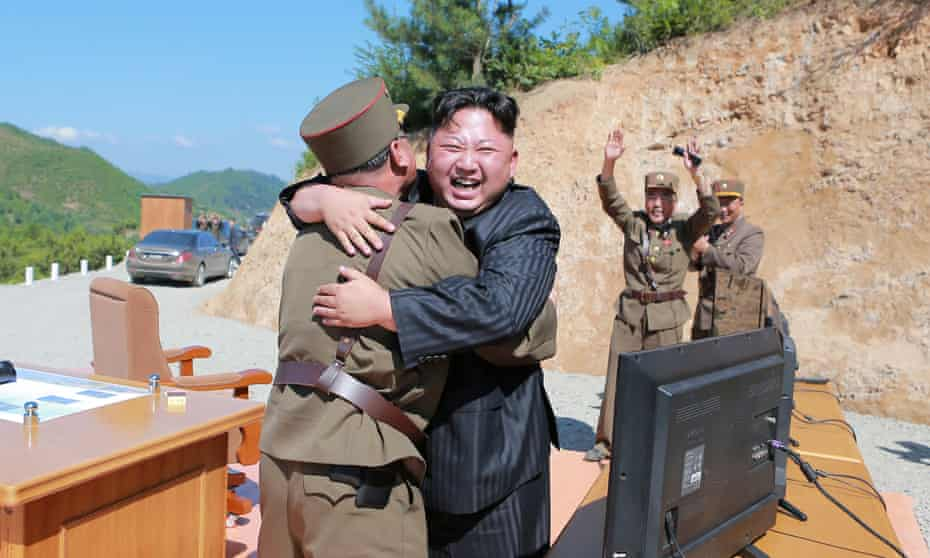Kim Jong-un reacts after a test launch in July