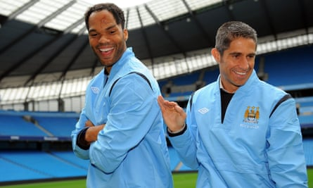 Sylvinho and his fellow new Manchester City signing Joleon Lescott in August 2009.