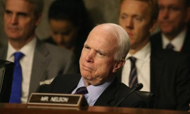 John McCain mocks Obama for calling climate change a threat as Isis advances