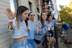 Balcony celebrations in the Alphabet City neighbourhood of Manhattan