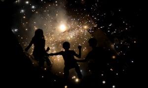 Children light fireworks in New Delhi for Diwali.