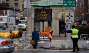 A pedestrian is given direction to a crosswalk by a traffic agent at W. 96th Street and Broadway in the Upper West Side of New York
