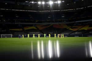 Players observe a moment of silence for the victims of the Covid-19 pandemic before the Europa League match between Inter Milan and Getafe at the Veltins-Arena.