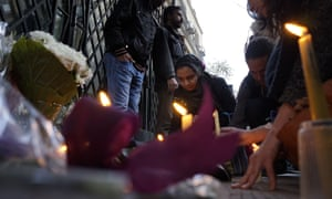 Mourners light candles and lay wreaths in memory of Giulio Regeni in front of the Italian embassy in Cairo.