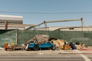 A car encampment on a sidewalk in an industrial area in Oakland, California, 31 July 2019.