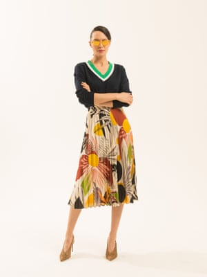 black jumper with green and white stripes on the v-neck section asos.com yellow green brown black cream floral patterned pleated skirt zara.com orange frame and lens sunglasses Chimi from brownsfashion.com animal print stiletto shoes dunelondon.com