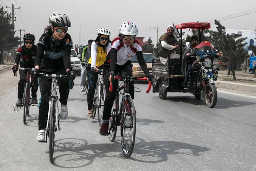 Members of the Afghan cycling federation's women's division, including Zahla Sarmat, the head of the division.