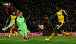 Arsenal's Danny Welbeck clips the ball over Mignolet.