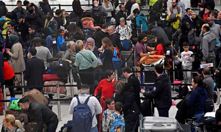 Passengers queue at check-in at Gatwick's South Terminal building.