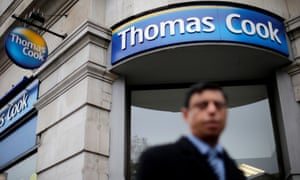 A pedestrian walks past a Thomas Cook shop in central London.