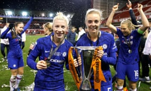 Double goalscorer Beth England (left) clutches the Continental Cup trophy as she celebrates Chelsea's victory with Sophie Ingle.
