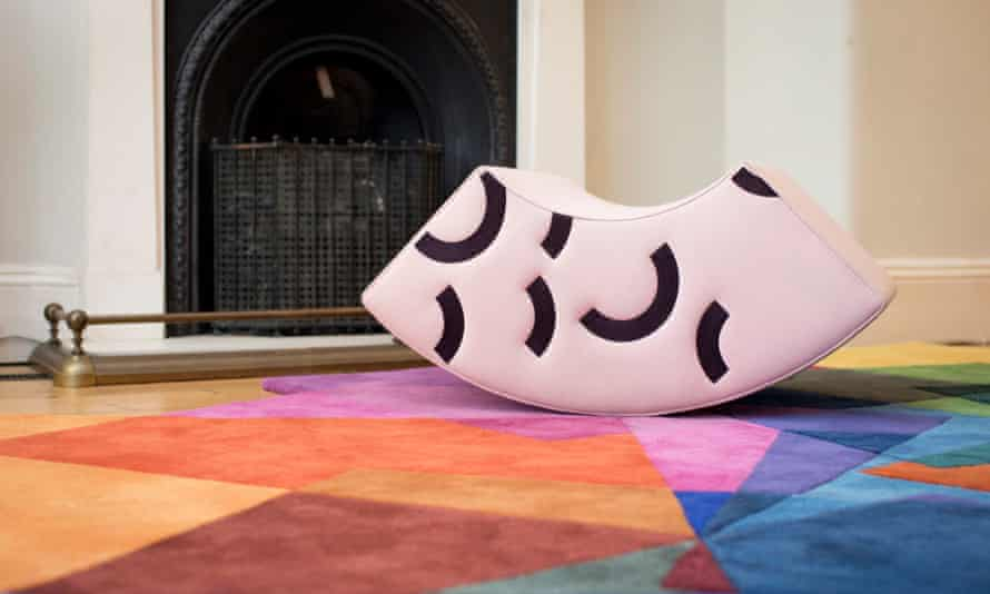 More furniture rented from Harth a multicoloured rug and a white and black seat.