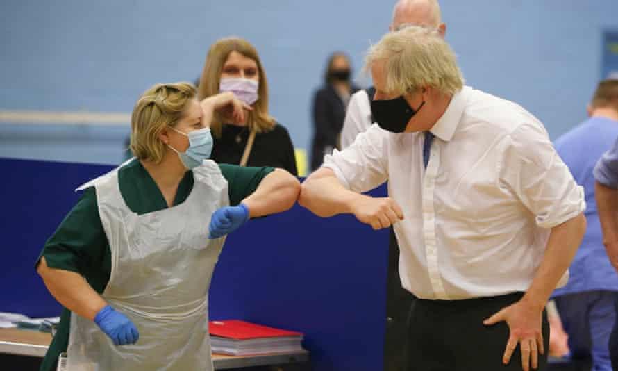 Boris Johnson touches elbows with a nurse at a vaccination centre