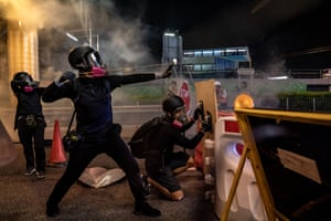 Protesters fire projectiles with slingshots.