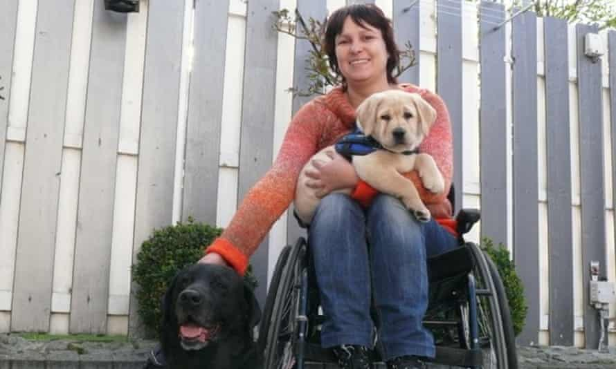 Sandra with assistance dogs Luca (the black Lab) and Wizzard.