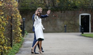 Prince Harry and Meghan Markle wave after posing for the media