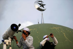 Students look for the moon from the roof of al-Musariin mosque in Jakarta
