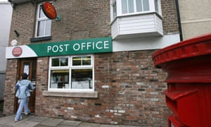 A woman enters the post office in Newton Newton-le-Willows, Lancashire