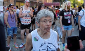 Martha Shelly, one of the original marchers in New York's first Gay Liberation parade in 1970, gathers with others outside the Stonewall Inn.