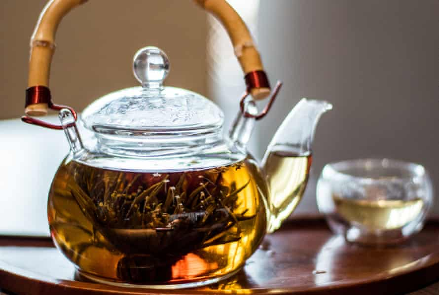 Jasmine tea in a traditional glass teapot with a bamboo handle in Shanghai, China