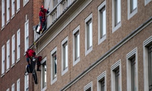 Greenpeace activists abseiled down the outside of the BP offices in London.
