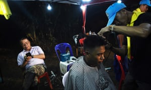 A man gets a free haircut at the command centre