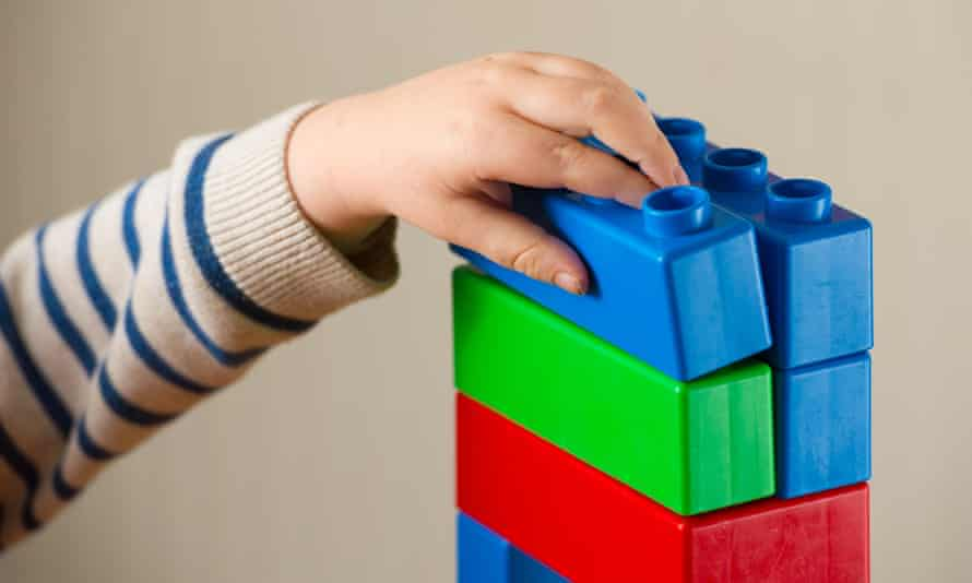 A child plays with building blocks