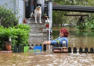 A woman attempts to access her home in Lismore