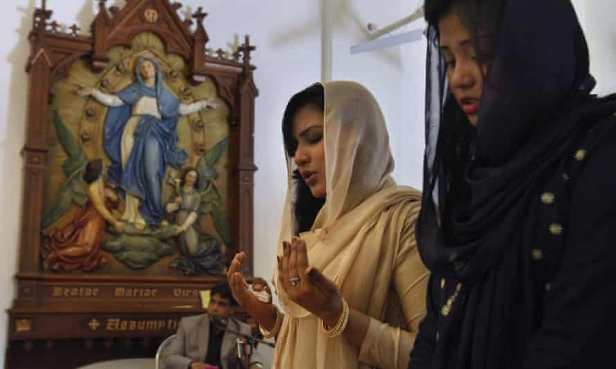 Christian women pray during a mass at St Joseph Cathedral in Rawalpindi on Easter Sunday.