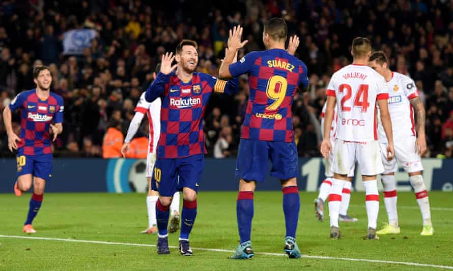 Lionel Messi celebrates with Luis Suárez after completing his hat-trick against Real Mallorca.