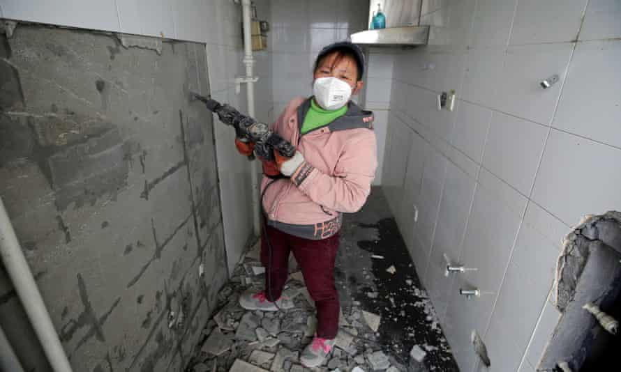 Deng Qiyan, a 47-year-old mother of three, works as a decorator at construction sites in Beijing, the Chinese capital