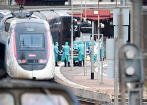 Medical staff evacuate an infected patient inside a medicalised TGV high-speed train