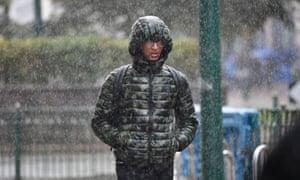 Morning commuters make their way through heavy rain in Birmingham.
