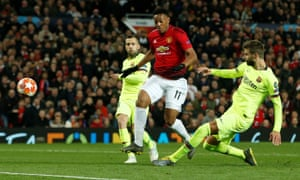 Barcelona's Gerard Pique in thwarts Manchester United's Anthony Martial.