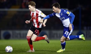 Denver Hume of Sunderland tries to get away from Alex Rodman of Bristol Rovers.