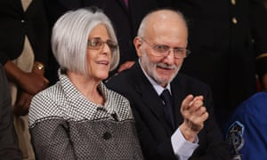 Alan Gross, recently freed after being held in Cuba since 2009, sits with wife Judy Gross before the start