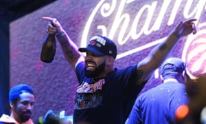 Drake celebrates on stage in Jurassic Park in Toronto after the Raptors defeated the Golden State Warriors 114-110.