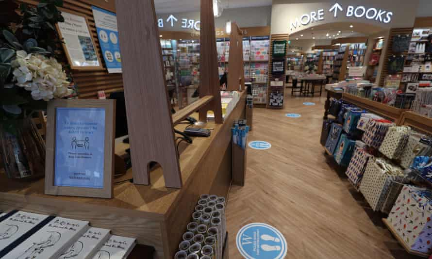 plexiglass screens behind tills to protect staff are installed in a London branch of Waterstones, ahead of its reopening on June 15.