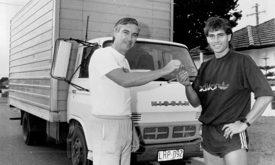 Australia striker Frank Farina, right, collects the keys to his four-tonne delivery truck off former Hearts defender Eddie Thomson who, we're assuming was also able to drive it.